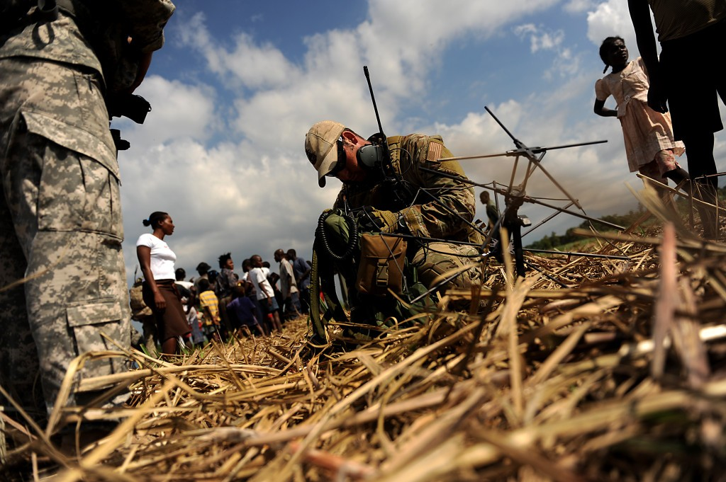 AFSOC personnel survey a relief supply drop zone in Haiti in 2010. Unmanned systems might be useful in future humanitarian operations, according to General Elton.