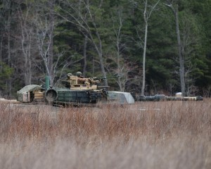 Marines from the Camp Lejeune-based 2nd Tank Battalion and 2nd Combat Engineer Battalion, 2nd Marine Division conduct armored breaching operations Mar. 17, 2015, at Fort Pickett, Va. Engineers supported A Co., 2nd Tank Battalion by firing an inert M58 Mine Clearing Line Charge, or MICLIC, from an M1 Assault Breaching Vehicle, while a platoon of M1A1 Abrams main battle tank maneuvered around several obstacles. Marines are training at Fort Pickett as part of a five-week Deployment For Training exercise, which tests the Marines ability to move a massive amount of personnel and equipment, while sustaining simulated combat operations. The exercise incorporates every combat requirement that the Marines are expected to perform during combat operations, to include: platoon and company-level maneuvers, targeting, individual and collective gunnery, logistics operations, convoy movements, and tank and infantry integration. (Photo by Capt. Andrew J. Czaplicki, Virginia Guard Public Affairs)