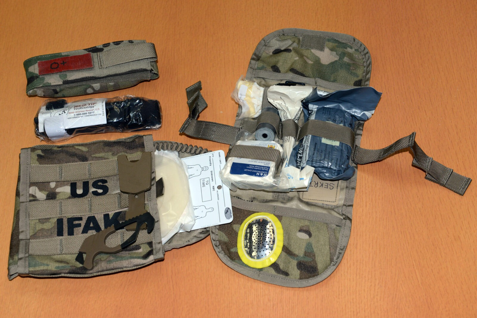 "The Army is now issuing to soldiers the more robust, more streamlined ""Individual First Aid Kit II"" as replacement for the older kit, which was built inside an ammunition pouch for a Squad Automatic Weapon. (C. Todd Lopez)"