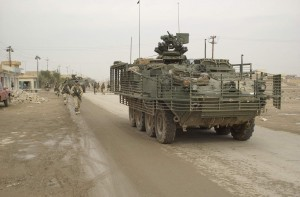 Soldiers of Battle Company, 5th Battalion - 20 Infantry, 3rd Brigade, 2nd Infantry Division (Stryker Brigade Combat Team) conduct route reconnaissance, a presence patrol, a civilian assessment, and combat operations contributing to the stability of Samarra, Iraq on December 15, 2003.  The 3rd Brigade, 2nd Infantry Division (Stryker Brigade Combat Team) is under the operational control of the 4th Infantry Division.  (U.S. Army photo by Spc. Clinton Tarzia) (Released)